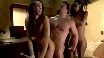 Two Sooty Ts ladies surprise tagteam fuck a muscly guy in his hotel room